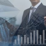 Double exposure, businessman using tablet with skyscraper and financial graph on financial background, business trading, business strategy analysis, economic growth report concept